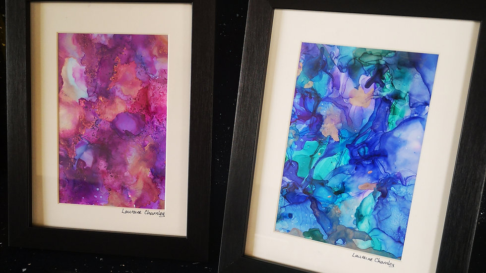 Pair of framed signed alcohol ink paintings.
