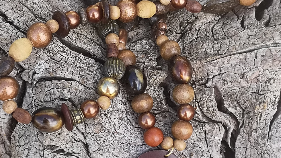 Long necklace with wood, nut, racotta and metal beads.