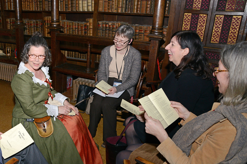 Women laughing in library
