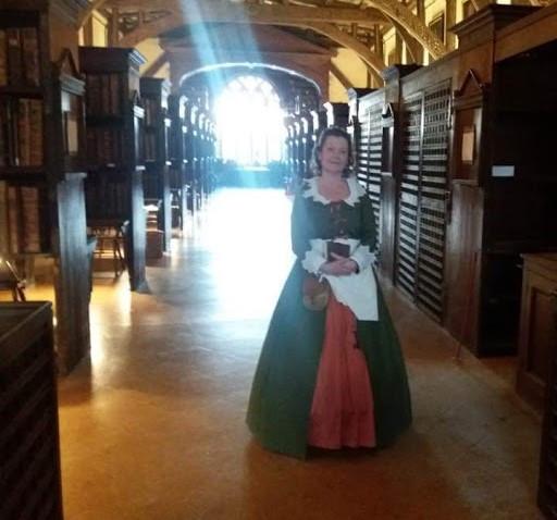 Jacobean woman in sunbeam in library