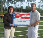 Eva Webb holding Conservation across America sign with grower