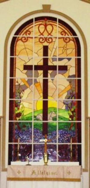 This is the stained glass window at the altar.