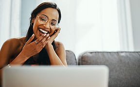 lady laughing at computer.jpg