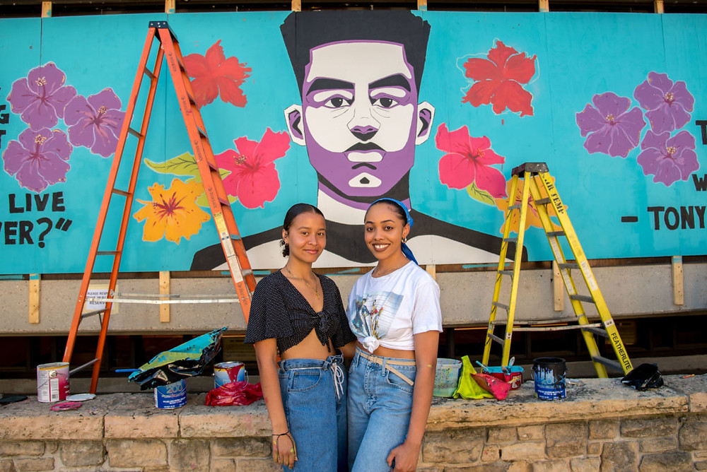 Danielle Mielke (left) and Amira Caire (right) in front of Tony Robinson Collaborative mural. Alana Caire was also a co-collaborator.