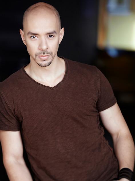 Headshot - Brown shirt