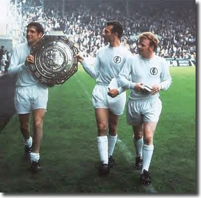 Norman Hunter, Paul Reaney and Billy Bremner show off the Charity Shield after beating Manchester Ci