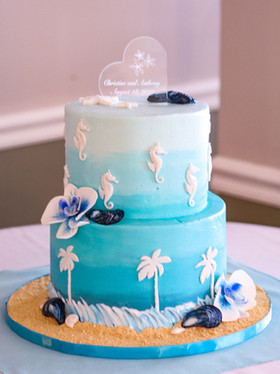Sea themed wedding cake with handmade sugar orchids. Photo Copyright Wildflour Cake Design