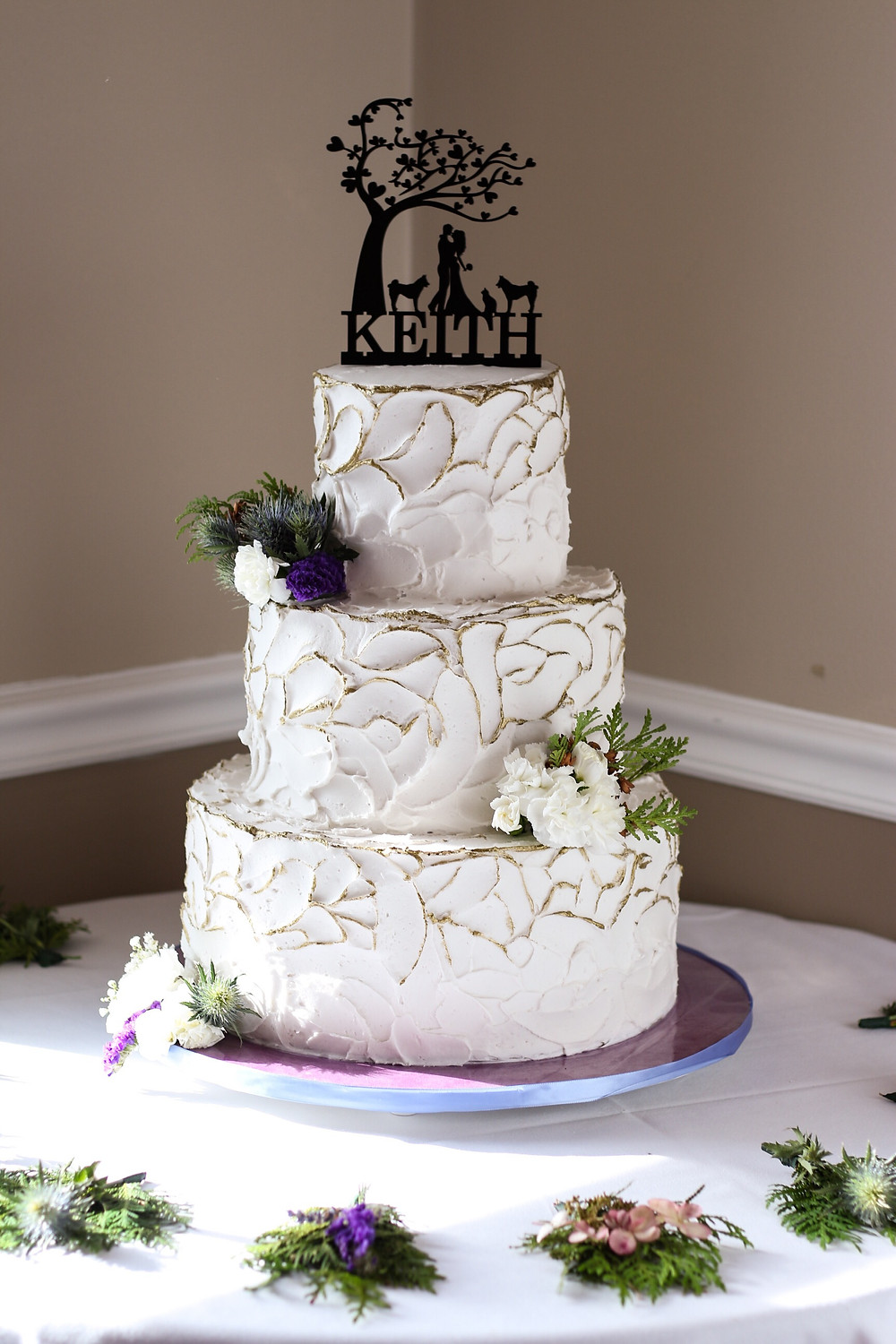 3 tiered wedding cake with gold