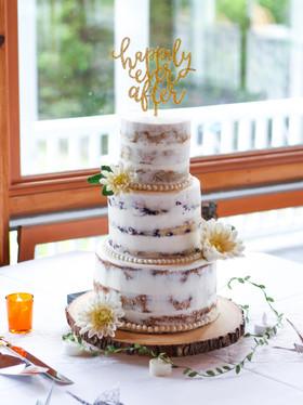 Semi-naked cake with handmade sugar dahlias. Photo Copyright Wildflour Cake Design