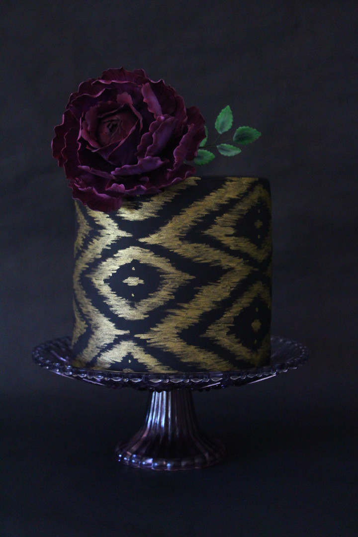 Black and Gold Ikat Cake with Purple Peo