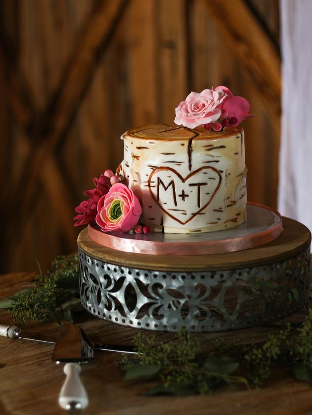 Carved birch bark cake with sugar flowers. Photo Copyright Wildflour Cake Design