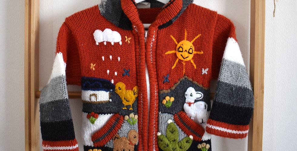 pletený farebný sveter so zvieratkami