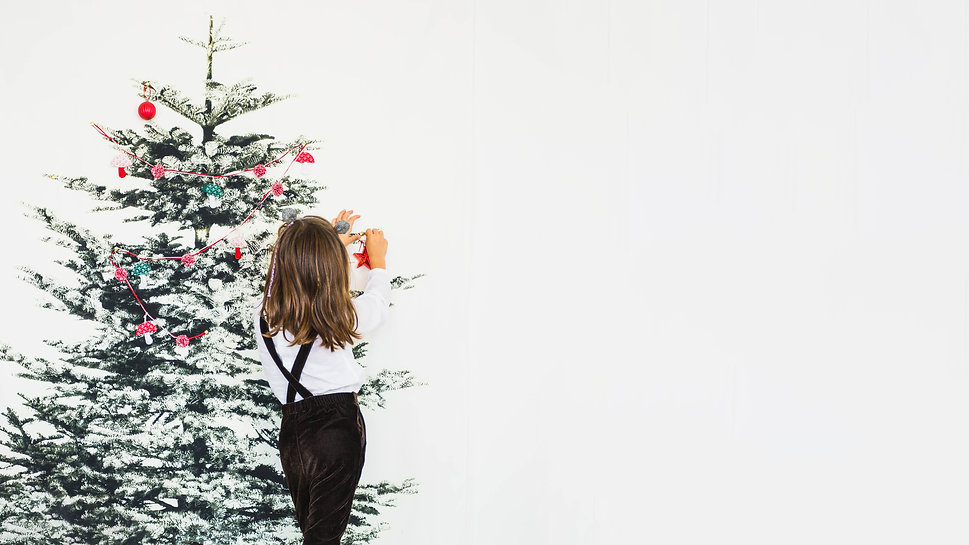 little-girl-decorating-christmas-tree.jp
