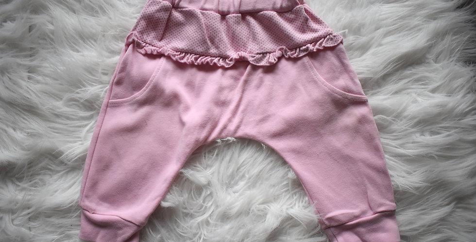 Ružové tepláčiky s elastickým pásom