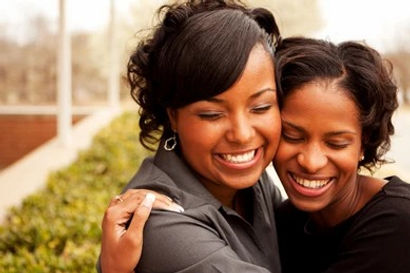 sisters-hugging-smiling-260nw-500192191_
