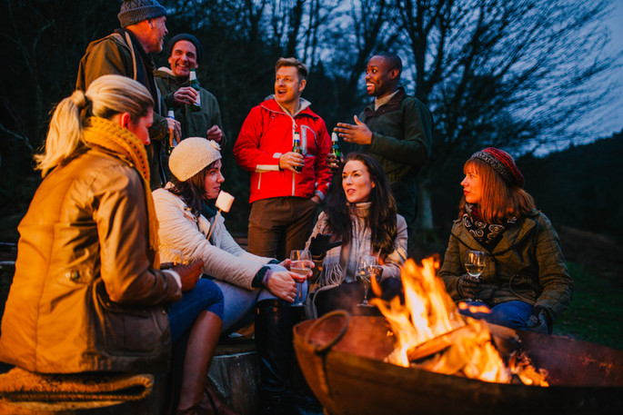 Group-of-Friends-Gathered-Around-a-Fire-