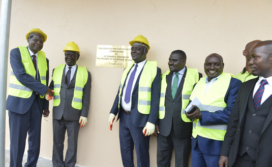 (Left to right): Xsabo's Dr. Alobo, Vice President Edward K. Ssekandi, Agriculture Minister Vincent Ssempijja and Julius Kanamwanji, leader of the youths (extreme right), pose infront of the coffee factory for the youth that was fully funded by The Xsabo Foundation.