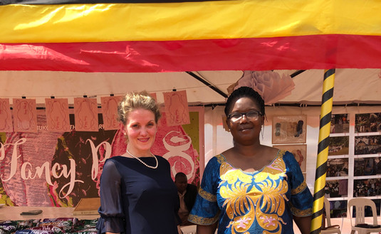 Franziska Leischker and Frances Ruth Atala, Directors of The Xsabo Foundation infront of the Fancy Pads exhibition at the Commissioning of the Solar Power Plant in Kabulasoke.