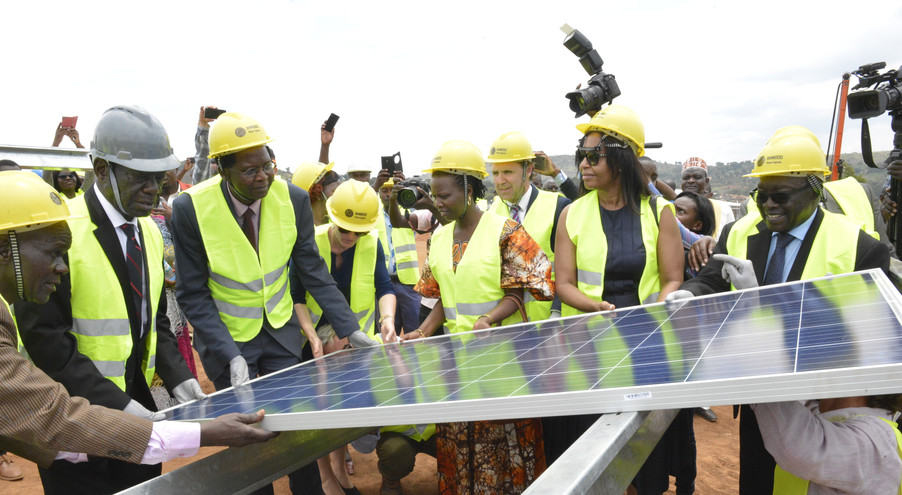 Vice President Edward K. Ssekandi (second left) lays the first module of The Xsabo Group's pilot solar power plant (20MW) in Kabulasoke in the presence of Richard S. Apire, Chairman of the Electricity Regulatory Authority (extreme right), and José Luis Moya, President of RiC Energy Group, which constructed the plant.