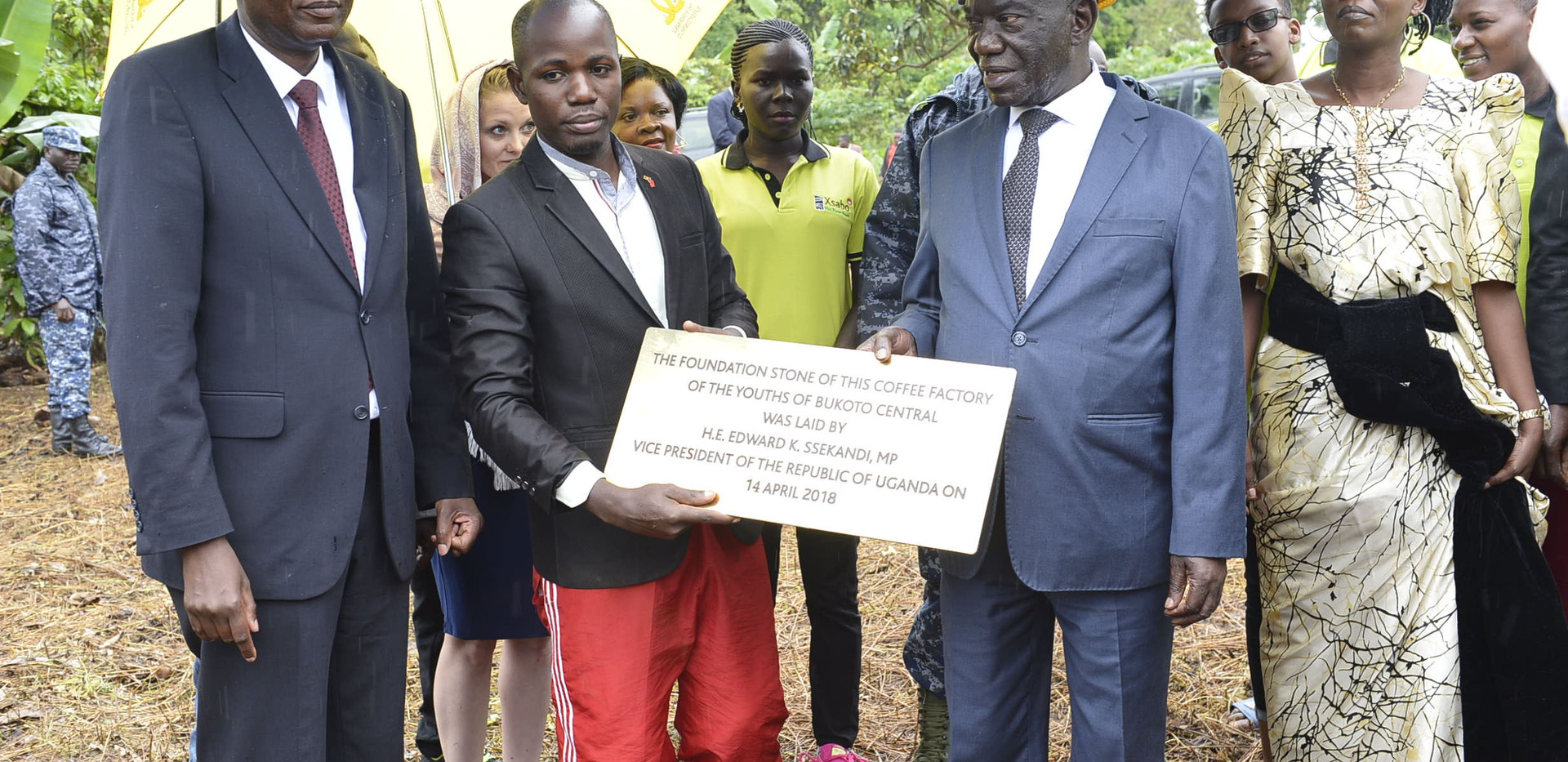 The foundation stone for the coffee factory for the youth was laid by Vice President Edward K. Ssekandi, here holding the plague together with Julius Kanamwanji, the youth leader.