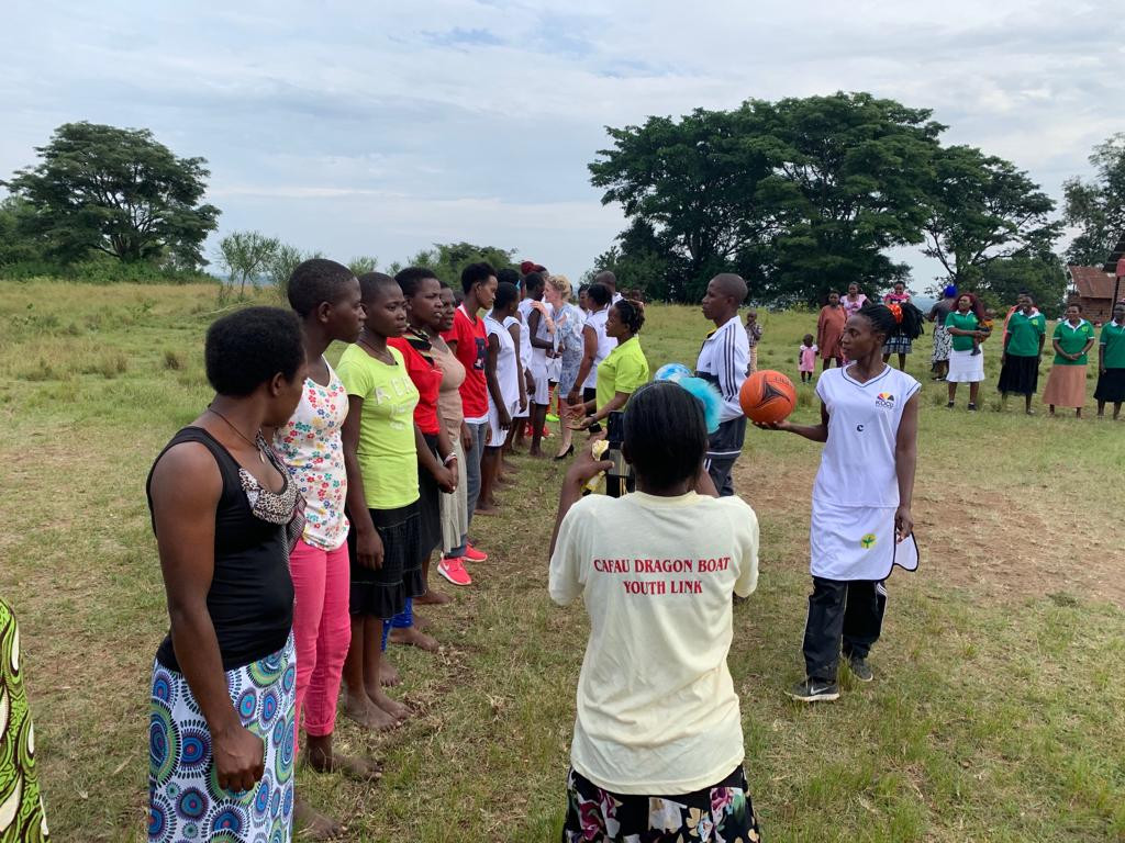 Franziska Leischker, a Director of The Xsabo Foundation, inspects the teams as Guest of Honour at one of the netball games in Greater Masaka Region.