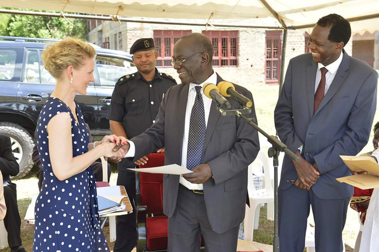 Uganda's Vice President Edward Ssekandi hands over a Certificate of Appreciation to 'Fancy Pads'