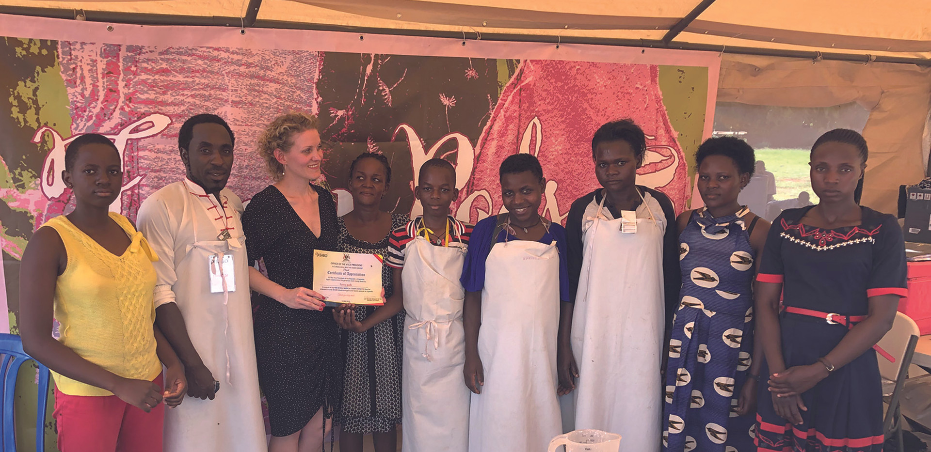The 'Fancy Pads' team received a certificate as recognition for their work by Vice President Edward K. Ssekandi.