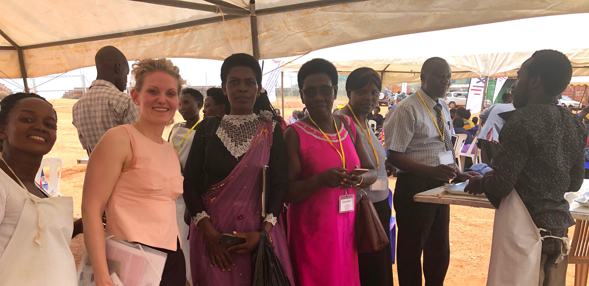 Damali Nabulya (left), Franziska Leischker (second left) and Ruth Sabitti (Resident Dirstrict Commissioner Gomba, fourth left) at the 'Fancy Pads' tent during one of the mobile medical camps in Kabulasoke.