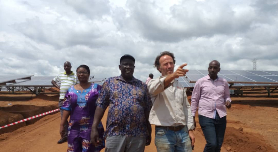 Dr. Tom Okurut (Executive Director, National Environment Management Authority) and Frances Ruth Atala (A Director of The Xsabo Foundation) on an inspection tour of Xsabo's Pilot Solar Power Park in Kabulasoke.