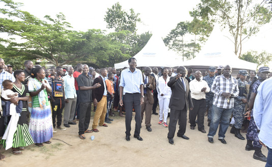 Vice President Edward K. Ssekandi, accompanied by Xsabo's Dr. Alobo, waves to the crowd at a football tournament sponsored by The Xsabo Foundation and the Office of the Vice President.