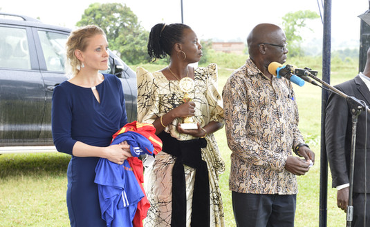 Vincent Musubire, Deputy Principal Private Secretary to H.E. the Vice President (right), Franziska Leischker, a Director of The Xsabo Foundation (left), and Beatrice A. Oling, Company Secretary a.i. of The Xsabo Group (middle), at a handover ceremony of sports uniforms, trophies and equipment sponsored by The Xsabo Foundation to various youth groups.