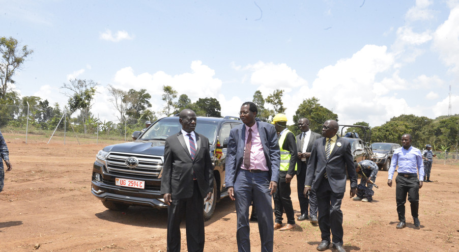 A humble beginning: Dr. David Alobo, CEO/Managing Director of The Xsabo Group, takes Vice President Edward K. Ssekandi on a tour of the construction site of one of the company's solar power plants in Uganda.