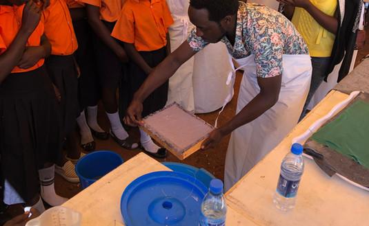 Joseph Tamale Ssekiziyivu demonstrating the making of 'Fancy Pads'.