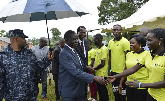 Vice President Ssekandi is welcomed by Xsabo ushers to lay the foundation stone for the coffee factory for the youth.