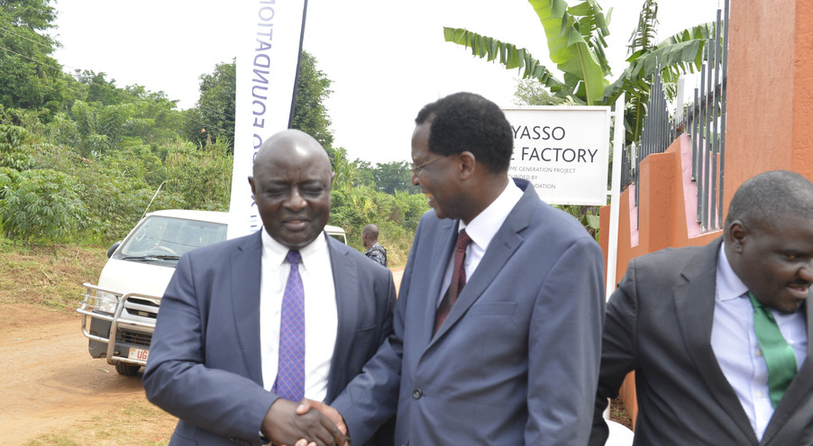 Vincent Ssempijja, Minister of Agriculture, Animal Husbandry and Fisheries, shares a light moment with Xsabo's Dr. Alobo.