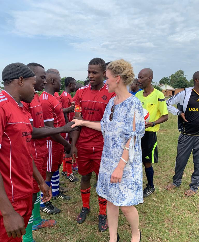 Franziska Leischker, a Director of The Xsabo Foundation, inspects the football teams as Guest of Honour at one of the games leading up to the finals of the Annual Youth Football Tournament in Bukoto Central.