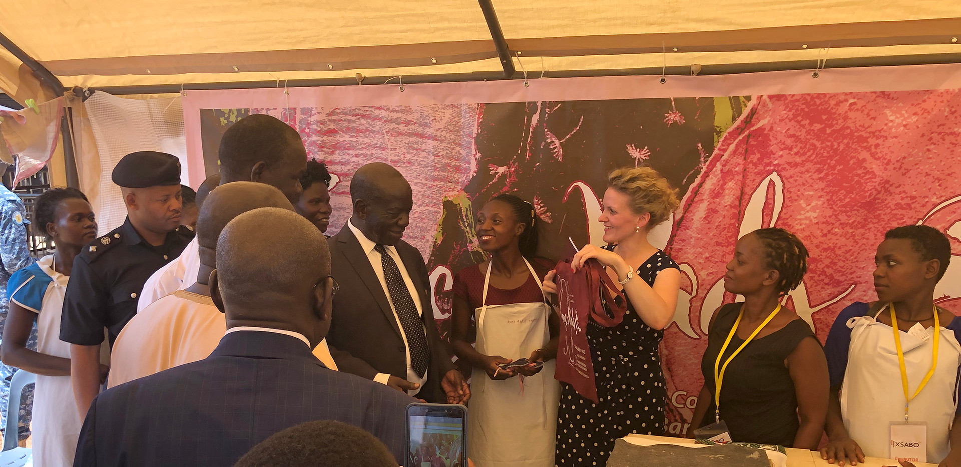 Members of the key team of 'Fancy Pads' - an initiative of The Xsabo Foundation in collaboration with Franziska Leischker - share their thoughts with Vice President Edward K. Ssekandi during one of their mobile workshops.