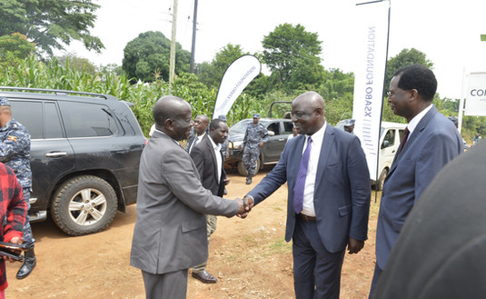 Vice President Edward K. Ssekandi arrives to open the coffee factory for the youth and is welcomed by Vincent Ssempijja, Minister of Agriculture, Animal Husbandry and Fisheries, and Xsabo's Dr. Alobo.