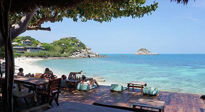 People relaxing at a beach bar in Sai Daeng bay koh Tao