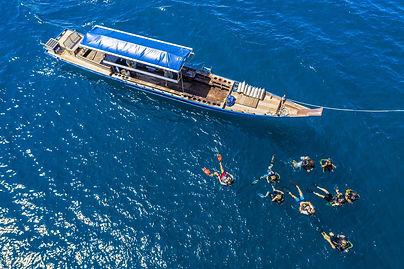 Scuba divers leaving CV Divers dive boat to go dive koh Tao's Shark island