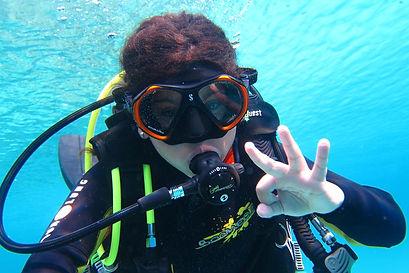 A young boy doing a bubblemaker scuba dive