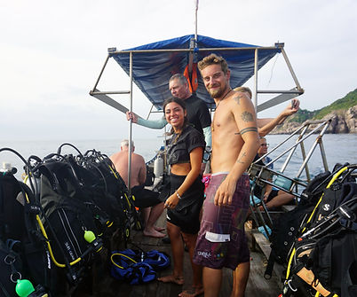 A scuba diving instructor with his recently certified student going diving in koh Tao