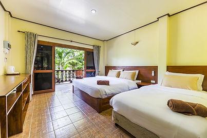 Beachfront room bedroom at Coral View resort koh Tao