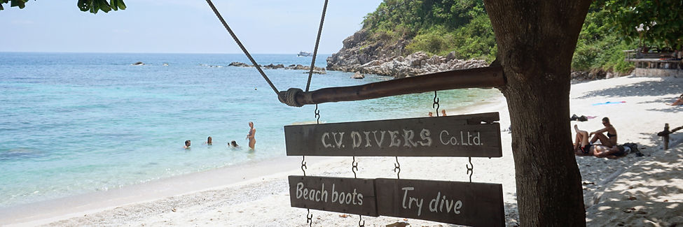 CV Divers business sign hanging over Sai Daeng bay in koh Tao