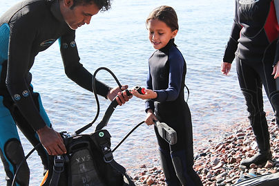 A young child getting ready to go scuba diving