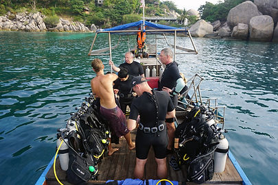 Scuba divers getting ready to go diving koh Tao
