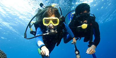 Two children scuba diving