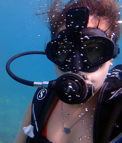 Discover Scuba diver successfully breathing underwater