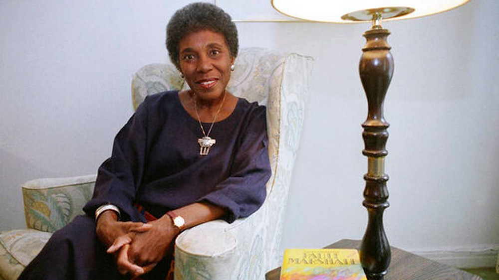 "FILE - In this Nov. 22, 1991 file photo, author Paule Marshall poses during an interview, in New York. The acclaimed fiction writer has died at 90. Marshall's son, Evan K. Marshall, told The Associated Press that she died Monday, Aug. 12, 2019 in Richmond, Va. Marshall was an exuberant and sharpened storyteller who drew upon classic and vernacular literature and her mother's kitchen conversations for such fiction as ""Brown Girl, Brownstones,"" ""Daughters"" and ""Praisesong for the Widow."" (AP Photo, File)"