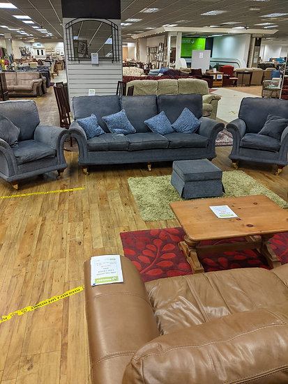 Midnight blue 3 seater sofa. Two chairs and footrest